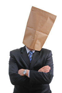 Man with a paper bag isolated on white background